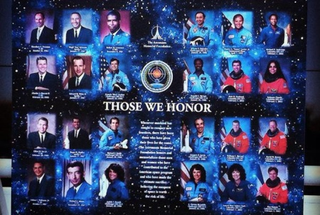Fallen astronauts and NASA personnel are pictured on a board displayed in front of the Space Mirror Memorial, Wednesday, Jan. 28, 2015, during NASA's Day of Remembrance. (PHOTO/Jon Shaban, Staff)